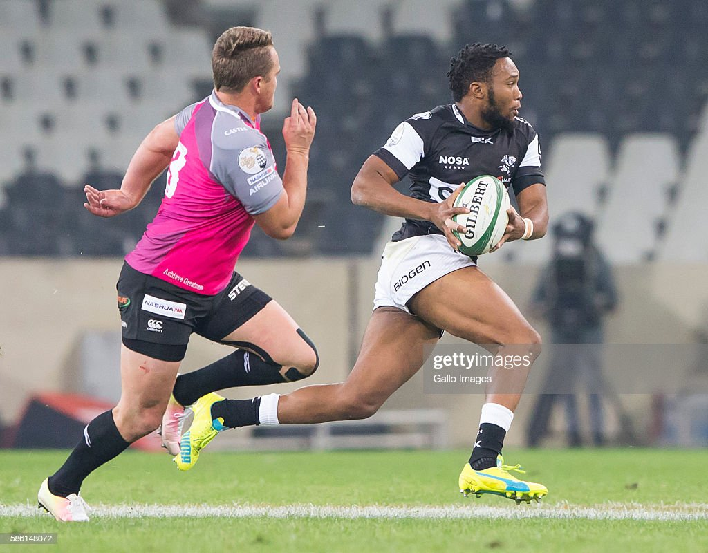 Lukhanyo Am of the Cell C Sharks and Hennie Skorbinski of the Steval Pumas during the Currie Cup match between Steval Pumas and Cell C Sharks XV at...