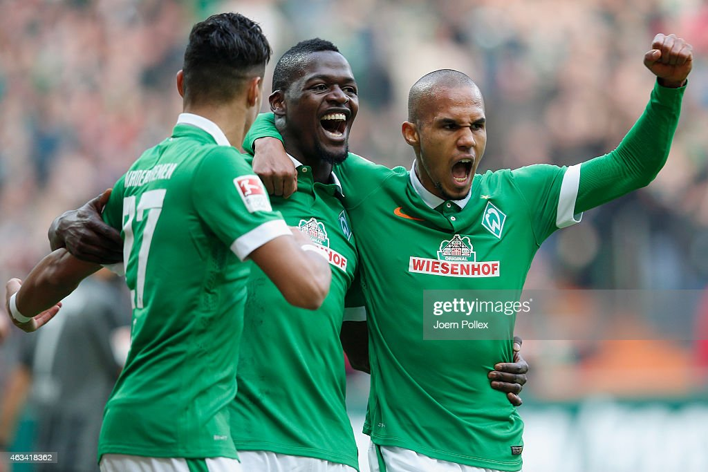 Lukimya Assani (C) of Bremen celebrates with his team mates after scoring his team's first goal during the Bundesliga match between SV Werder Bremen and FC Augsburg at Weserstadion on February 14, 2015 in Bremen, Germany.