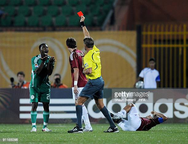 Lukman Haruna of Nigeria is sent off by referee Roberto Rosetti during the FIFA U20 World Cup Group B match between Nigeria and Venezuela at the Al...