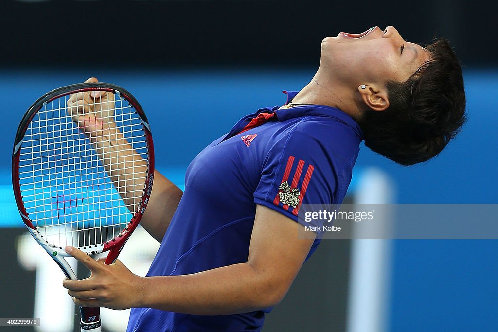 Luksika Kumkhum of Thailand celebrates winning her first round match against Petra Kvitova of the Czech Republic during day one of the 2014 Australian Open at Melbourne Park on January 13, 2014 in Melbourne, Australia.