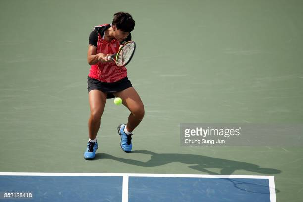 Luksika Kumkhum of Thailand plays a shot against Jelena Ostapenko of Latvia during day six of the KEB Hana Bank Incheon Airport Korea Open at the...