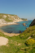 Beautiful Lullworth cove with ships in Dorset countryside, United Kingdom