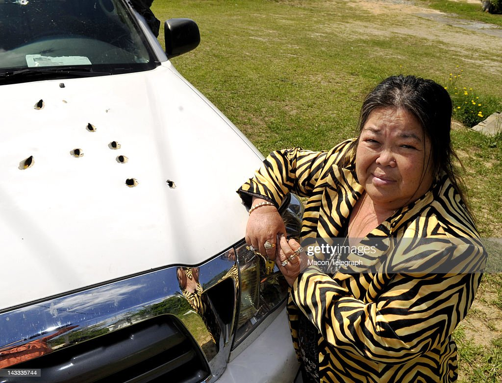 Lulu Campbell stands beside her bullet-riddled Toyota Tundra truck, April 23, 2012. She was driving this truck when two men attempted to rob her Saturday night in Macon, Georgia. The two men shot at her and she returned fire, hitting one of the robbers.