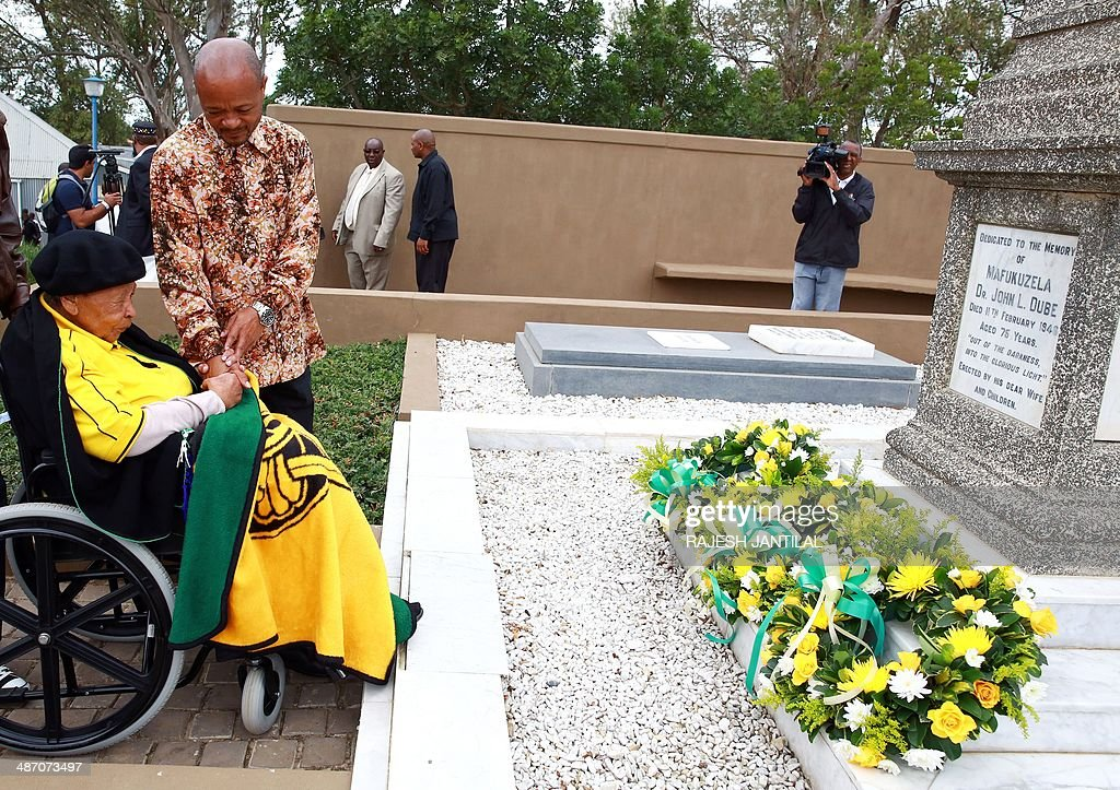 Lulu Dube (L), 85, the last surving sibling of one of the African National Congress (ANC) founders and its first President John Dube, and the Kwazulu Natal Premier Senzo Mchunu (2nd L) pay their respects after laying a wreath on April 27, 2014 at the Ohlanga High School where Nelson Mandela cast his vote on April 27, 1994 in the first democratic elections of the post-Apartheid era. Freedom Day celebrations mark the 20th anniversary of the country's first democratic elections in the post-Apartheid era.