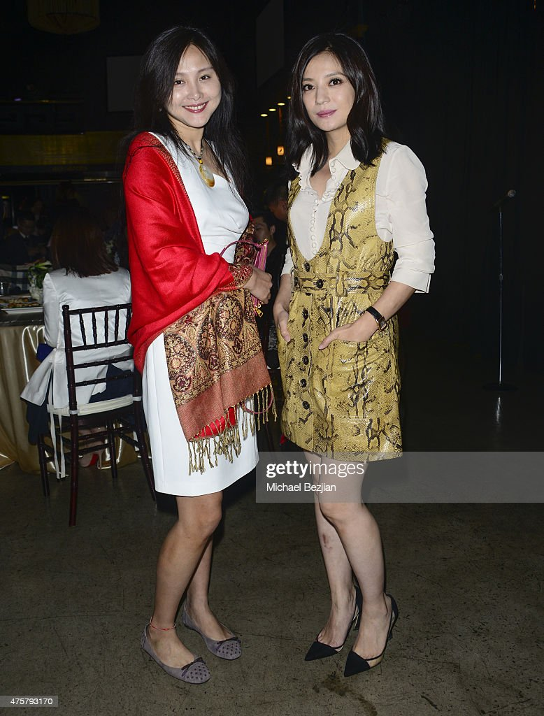 LuLu Huan and Actress Zhao Wei pose for portrait at Bruno Wu and Seven Stars Entertainment Sponsor TCL Chinese Theatre Handprints For Director Justin...