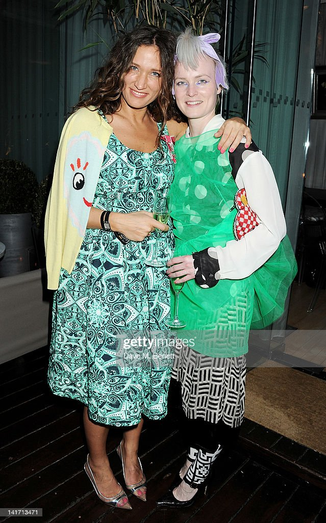Lulu Kennedy and designer Louise Gray attend a tea party hosted by fashion designer and founder of the Fashion East Initiative Lulu Kennedy in...