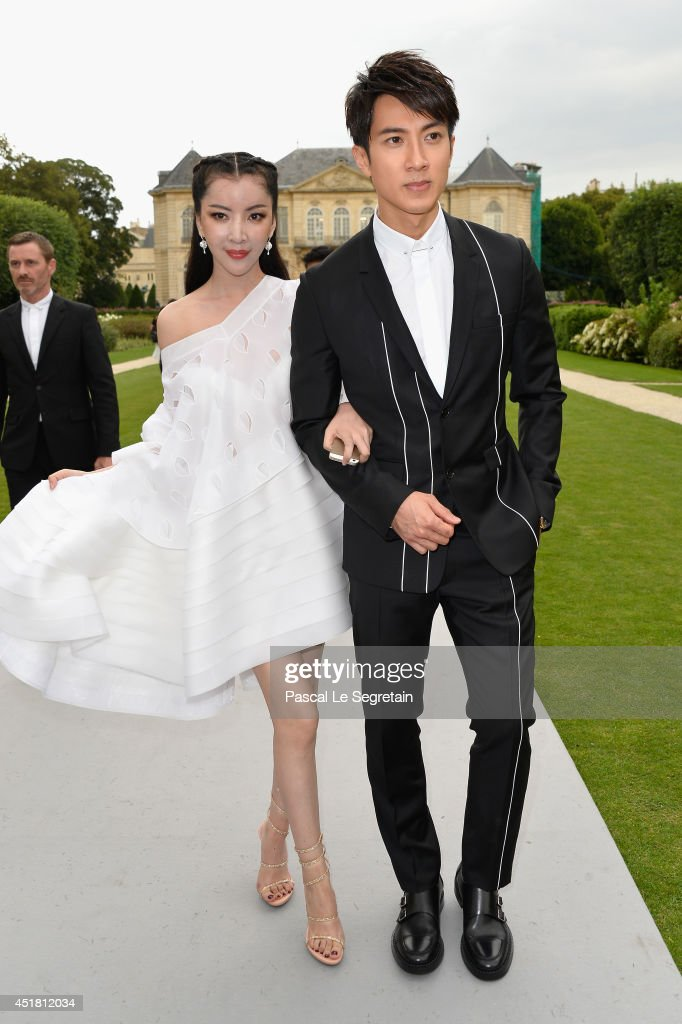 Lulu Tan and Zan Wu attend the Christian Dior show as part of Paris Fashion Week - Haute Couture Fall/Winter 2014-2015 on July 7, 2014 in Paris, France.