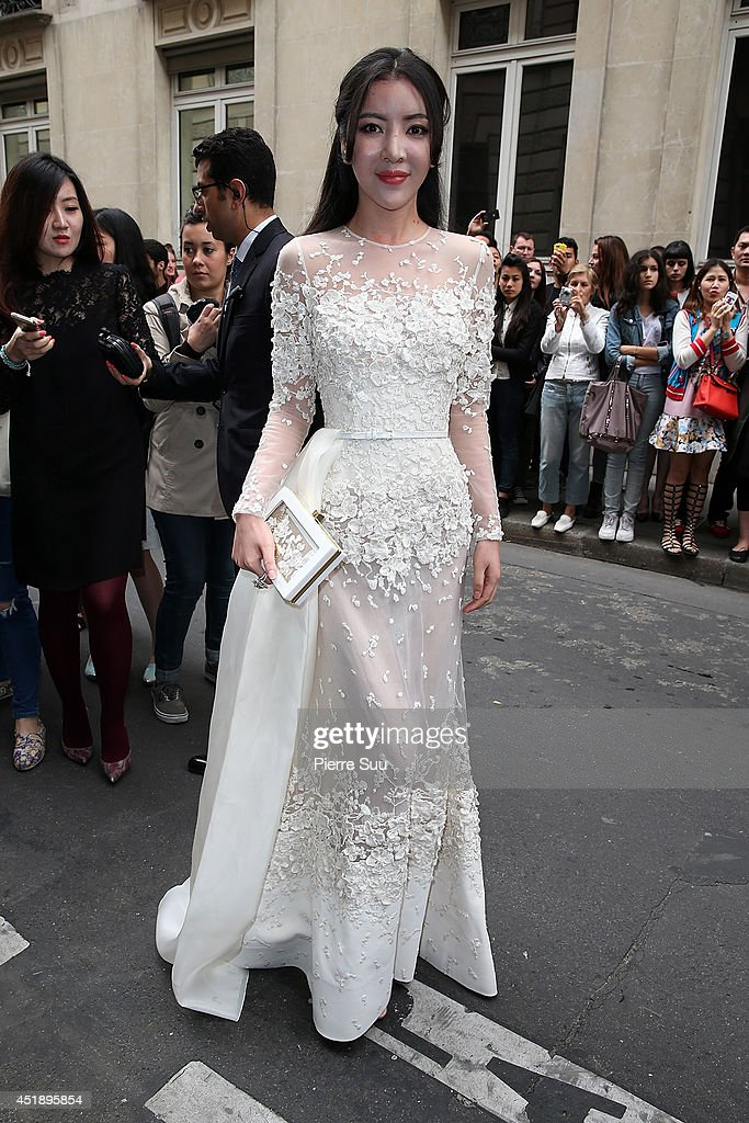 Lulu Tan attends the Elie Saab show as part of Paris Fashion Week - Haute Couture Fall/Winter 2014-2015 at Pavillon Cambon Capucines on July 9, 2014 in Paris, France.