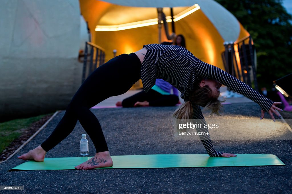 lululemon athletica hosts an out of the ordinary yoga class at the Serpentine Pavilion as a celebration of summer on August 20 2014 in London England