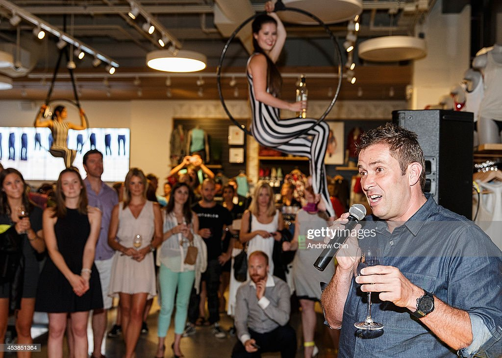 Lululemon CEO Laurent Potdevin (R) speaks to the audience during the Lululemon Athletica flagship store opening party at 970 Robson Street on August 19, 2014 in Vancouver, Canada.