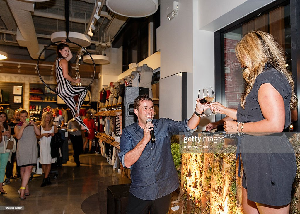 Lululemon CEO Laurent Potdevin toasts a glass of wine with Lululemon Flagship Store Manager Katelynne Kaytona during the Lululemon Athletica flagship store opening party at 970 Robson Street on August 19, 2014 in Vancouver, Canada.