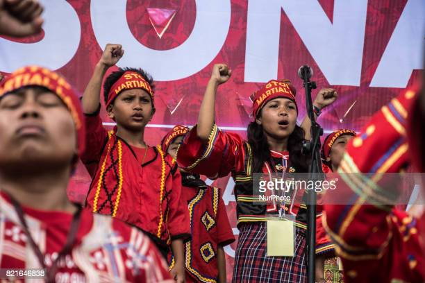 Lumad youth performs on stage in an antiDuterte protest in Batasan Quezon City Tribal schools have been allegedly attacked by the military President...
