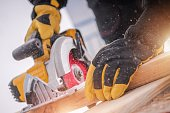 Lumber Woodwork Tools. Wood Construction. Circular Saw in Action.