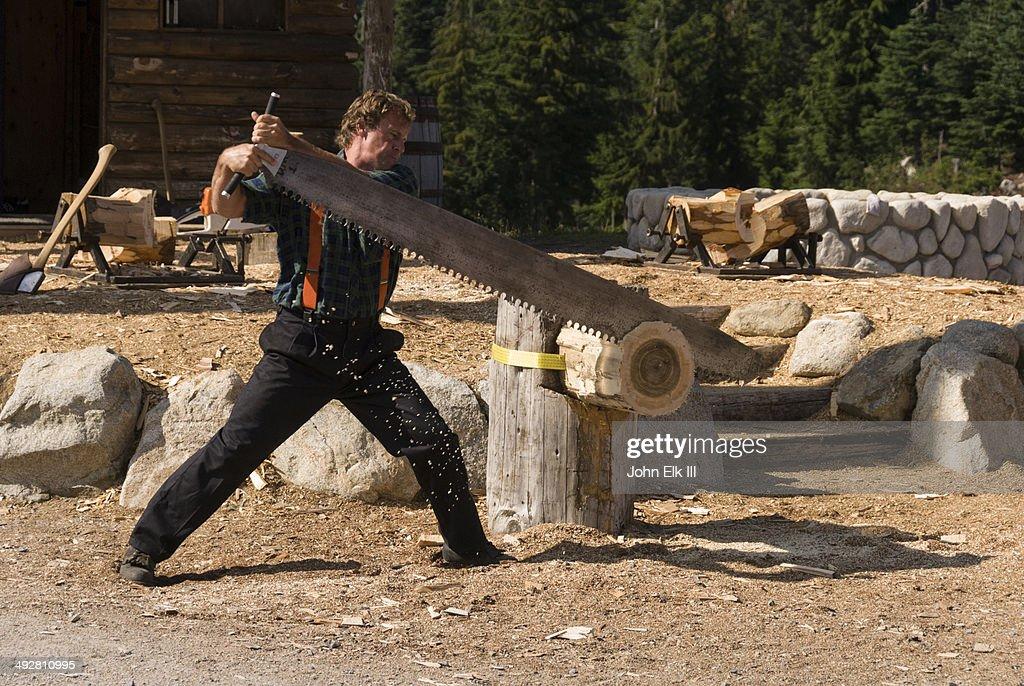 Lumberjack log-sawing demonstration : Stock Photo