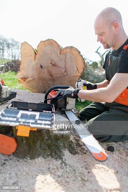 Lumberjack refueling motor saw