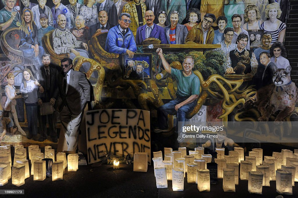 Luminaries surrond the Inspiration mural in State College, Pennsylvania, during a candlelight vigil marking one year since Joe Paterno's death on Tuesday, January 22, 2013.