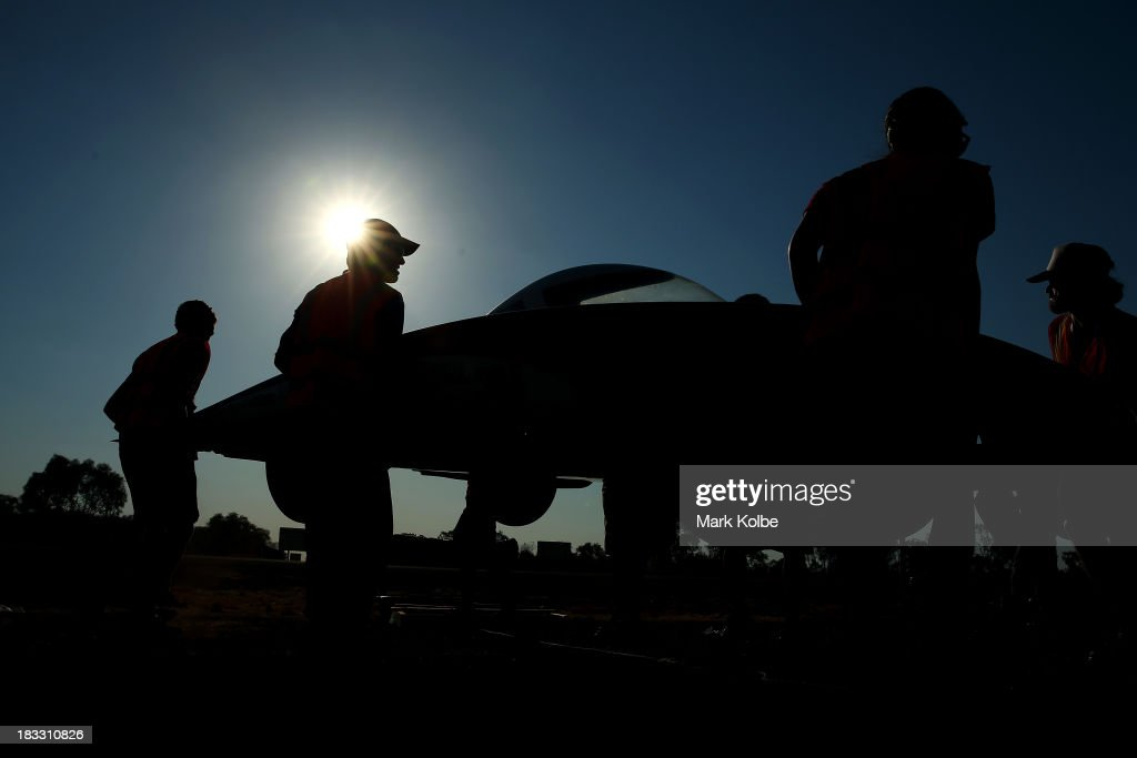 Luminos from the Stanford Solar Car Project, Stanford University in the United States of America is carried by team members ahead of the overnight stop at the end of racing on Day 1 on October 6, 2013 in Elliott, Australia. Over 25 teams from across the globe will compete in the 2013 World Solar Challenge - a 3000 km solar-powered vehicle race between Darwin and Adelaide. The race begins today with the first car expected to cross the finish line on October 10th.