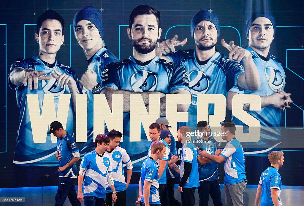 Luminosity shakes hands with Cloud9 after winning the match at the ELeague Arena at Turner Studios on May 28, 2016 in Atlanta, Georgia.