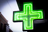 Luminous green cross. No people