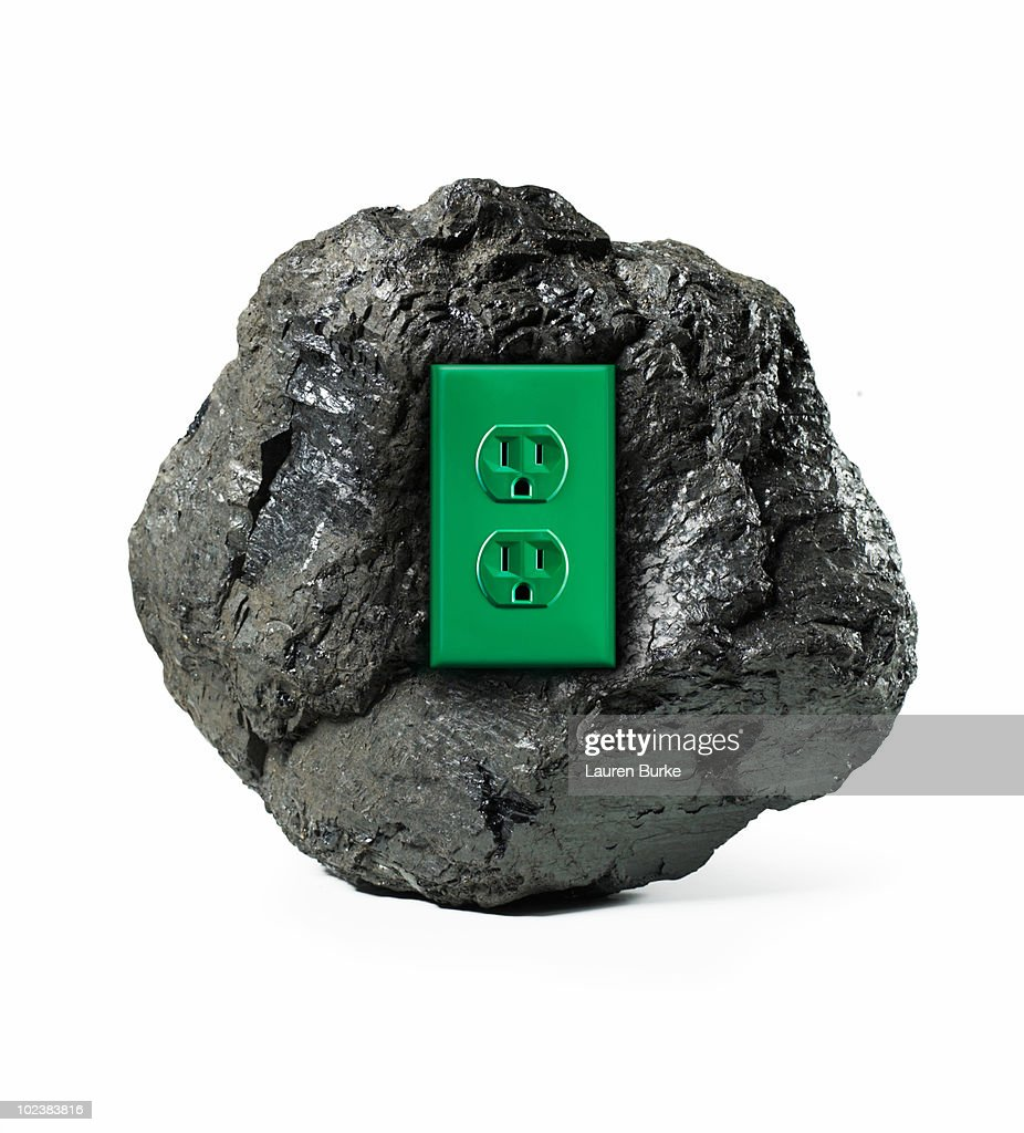 Lump of Coal With Green Electrical Outlet : Stock Photo