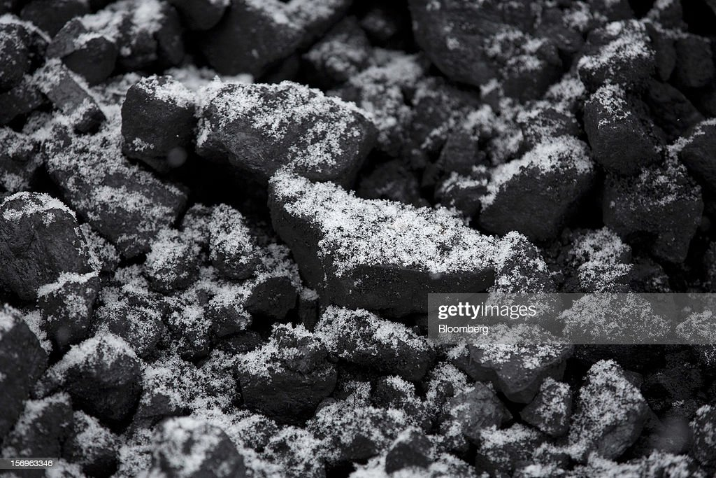 Lumps of coal sit covered in snow at an outdoor storage site at the Sibirginsky open pit coal mine, owned by OAO Mechel and operated by Southern Kuzbass Coal Co., near Myski, in Kemerovo region of Siberia, Russia, on Friday, Nov. 23, 2012. OAO Mechel is Russia's biggest maker of steelmaking coal. Photographer: Andrey Rudakov/Bloomberg via Getty Images