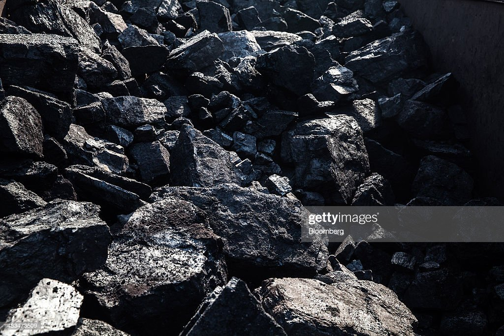 Lumps of coal sit on the ground at an open pit coal mine in the Bestacolla Colliery in Jharia, Jharkhand, India, on Sunday, April 6, 2014. Coal India Ltd., the worlds largest producer, estimates on its website that the nation faces a supply deficit of 350 million tons by 2016-2017, thereby overtaking import demand from China, the worlds biggest coal consumer and producer. Photographer: Sanjit Das/Bloomberg via Getty Images