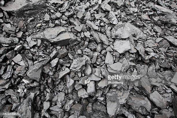 Lumps of coal sit on the ground at the PT Exploitasi Energi Indonesia open pit coal mine in Palaran East Kalimantan province Indonesia on Friday Sept...