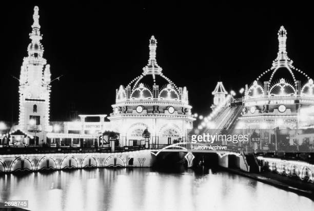Luna Park on Coney Island New York lit up at night and advertising the attractions of the 'Human Dynamo'