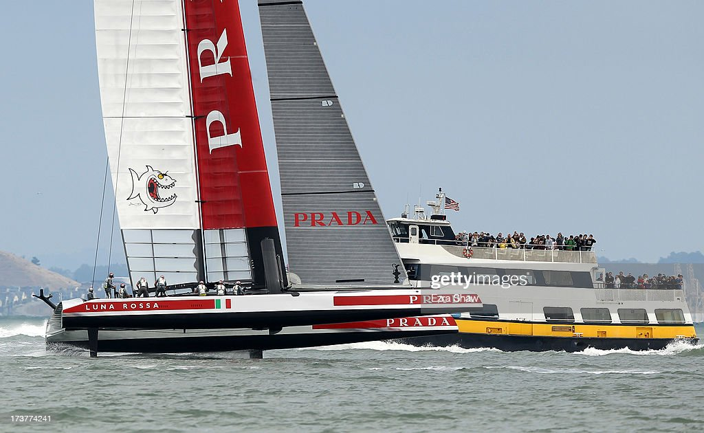 Luna Rossa Challenge makes its way past a ferry boat while training for the America's Cup sailing event on July 17, 2013 in San Francisco, California. Emirates Team New Zealand is currently competing in the Louis Vuitton Cup. The winner of the Louis Vuitton Cup goes on to race against Oracle Team USA in the America's Cup Finals that start on September 7.