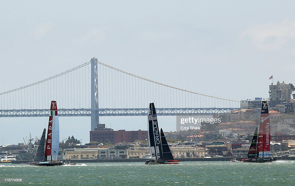Luna Rossa Challenge, Oracle Team USA, and Emriates Team New Zealand make their way past the San Francisco-Oakland Bay Bridge while training for the America's Cup sailing event on July 17, 2013 in San Francisco, California. Emirates Team New Zealand and Luna Rossa Challenge are are currently competing in the Louis Vuitton Cup. The winner of the Louis Vuitton Cup goes on to race against Oracle Team USA in the America's Cup Finals that start on September 7.