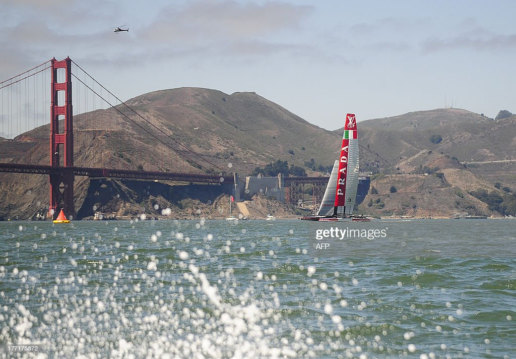 Luna Rossa Challenge sails near the Golden Gate Bridge while competing in the fourth race of the Louis Vuitton Cup in San Francisco, California on August 21, 2013. AFP PHOTO/Josh Edelson