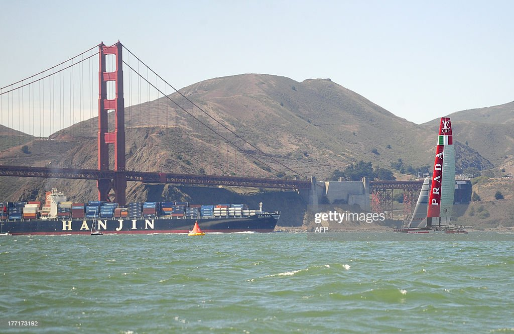 Luna Rossa Challenge sails their AC72 near the Golden Gate Bridge as it competes in the fifth race of the Louis Vuitton Cup in San Francisco, Calif. on August 21, 2013. AFP PHOTO/Josh Edelson