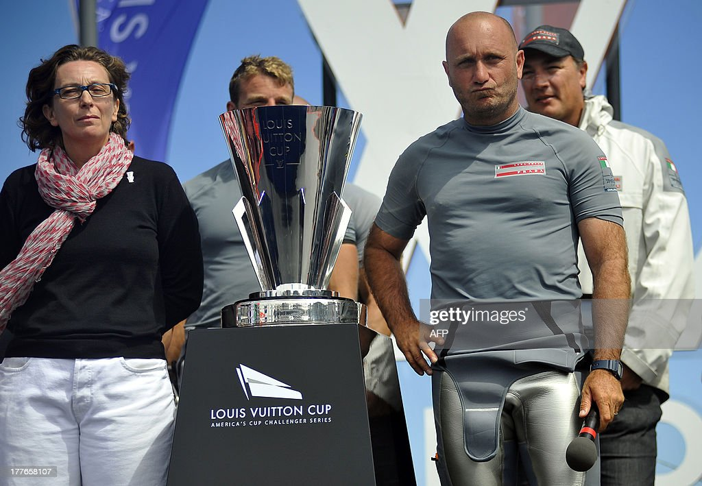Luna Rossa Challenge Skipper Max Sirena pauses next to the Louis Vuitton Cup during a ceremony in San Francisco, California on August 25, 2013. Emirates Team New Zealand won the series 7-1 against Luna Rossa. AFP PHOTO / Josh Edelson