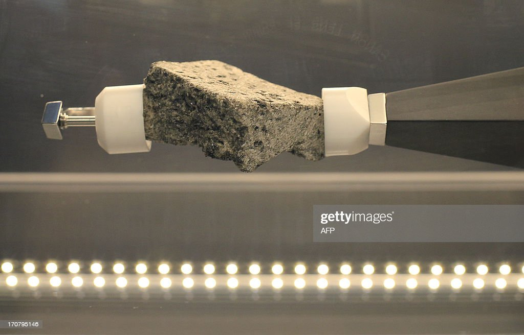 A lunar basalt rock is displayed at the Meteorite room of the Natural History Museum (Naturhistorisches Museum Wien NHM) in Vienna on June 18, 2013. The approx. 84 grams (2.96 Oz) basalt stone is displayed at the museum and was brought during the 'Apollo 15' mission in 1971.