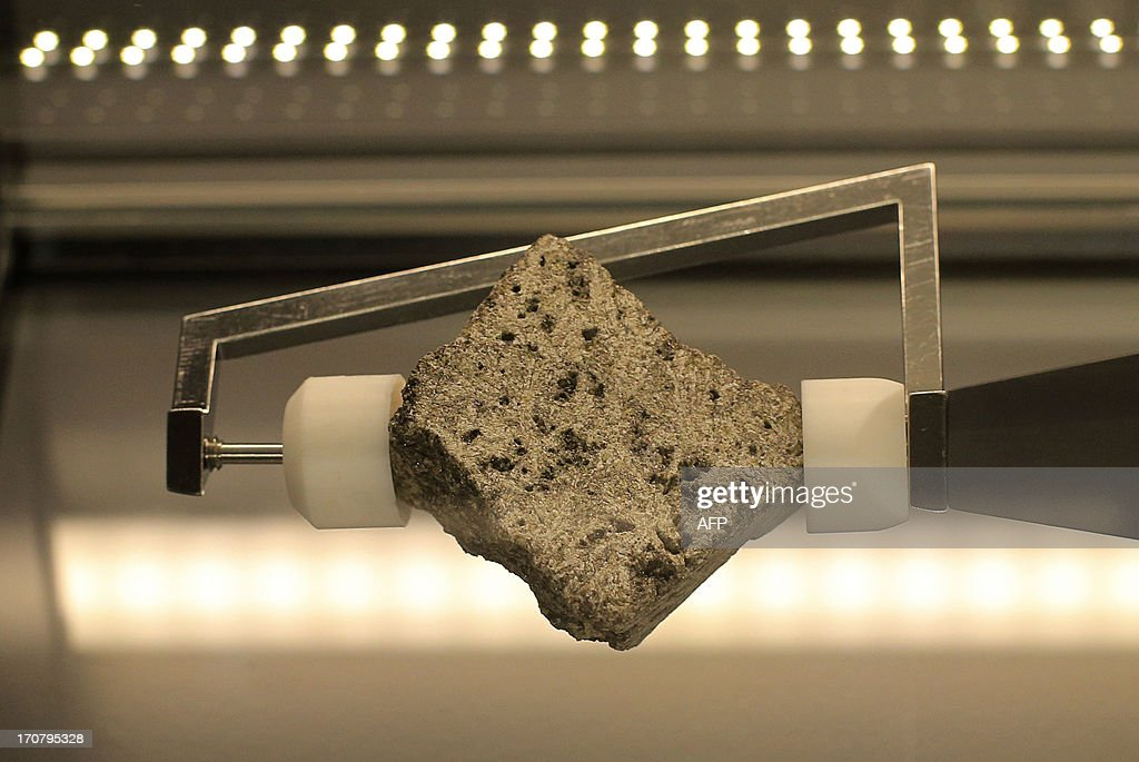 A lunar basalt rock is displayed at the Meteorite room of the Natural History Museum (Naturhistorisches Museum Wien NHM) in Vienna on June 18, 2013. The approx 84 grams (2.96 Oz) basalt stone is displayed at the museum and was brought during the 'Apollo 15' mission in 1971. AFP PHOTO / ALEXANDER KLEIN