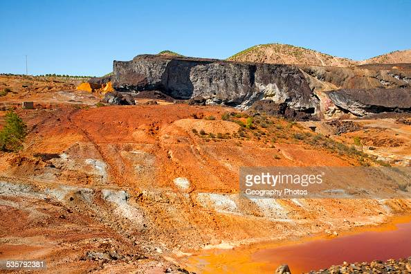 Lunar like despoiled landscape from opencast mineral extraction in the Minas de Riotinto mining area Huelva province Spain