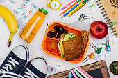 Lunch box and school supplies. Education concept. Top view