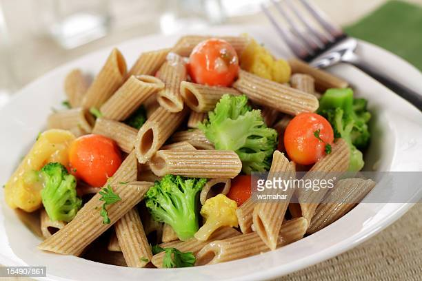 Lunch consisting of whole wheat pasta and vegetables