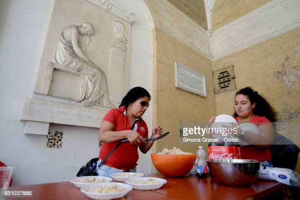 Lunch distribution in the Colonnade of the Basilica where dozen of families live since August 11 after leaving the occupied palace in Quintavalle...