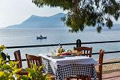Lunch in a restaurant overlooking the sea, Greece, Santorini