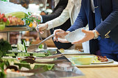 Businesswoman picking from a salad bar