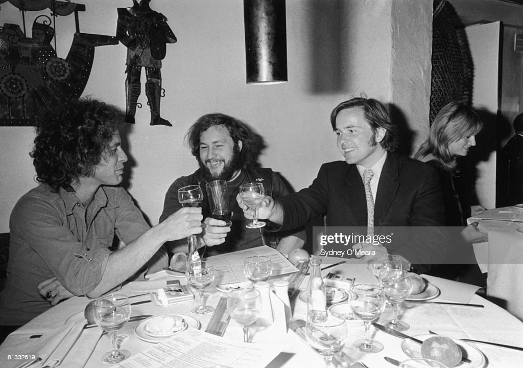 A luncheon held for Hell's Angels president 'Buttons' at the Trattoria Terrazza in Soho, 16th September 1971. From left to right, publisher William Bloom, Buttons, and publisher Anthony Cheetham.