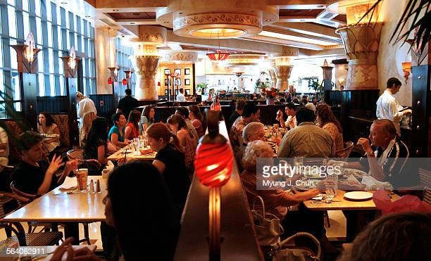 A lunchtime crowd packs the dining room at the Cheesecake Factory in Sherman Oaks on Friday July 28 2006 High gas prices have caused people to spend...