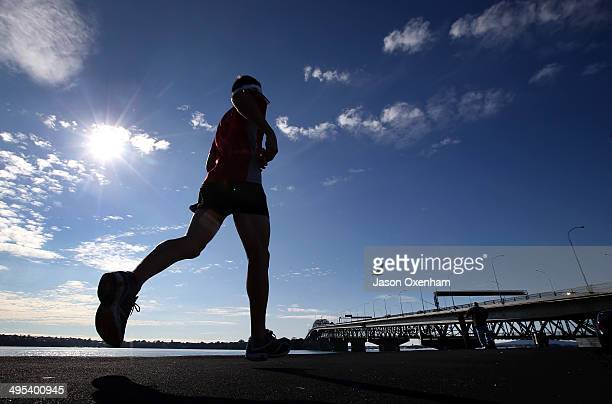 A lunchtime jogger takes advantage of the sunshine running along Curran Street towards the Auckland Harbour Bridge on June 3 2014 in Auckland New...