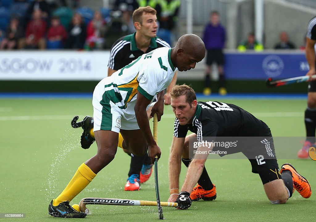 Lungile Tsolekile of South Africa is challanged by Richard Gay of Wales during the men's preliminaries match between Wales and South Africa at the Glasgow National Hockey Centre during day six of the Glasgow 2014 Commonwealth Games on July 29, 2014 in Glasgow, United Kingdom.