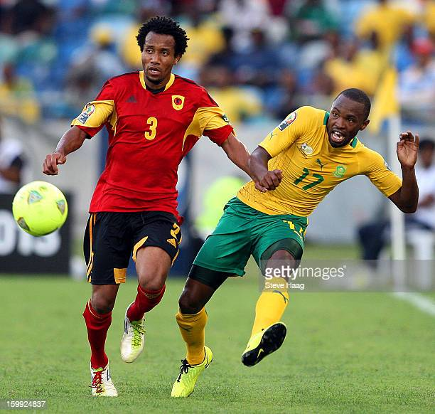 Lunguinha of Angola in action against Bernard Parker of South Africa during the 2013 African Cup of Nations match between South Africa and Angola at...