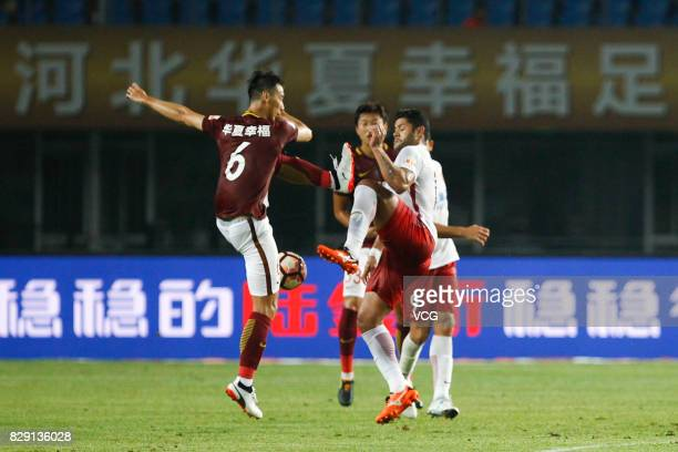 Luo Senwen of Hebei China Fortune and Hulk of Shanghai SIPG vie for the ball during the 21st round match of 2017 China Super League between Hebei...