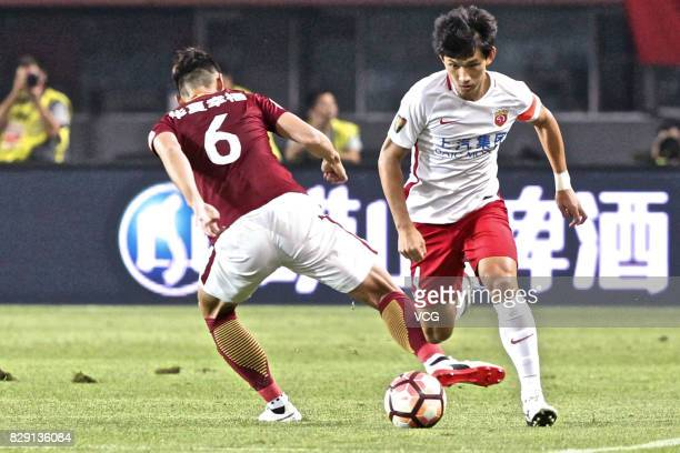 Luo Senwen of Hebei China Fortune and Wang Shenchao of Shanghai SIPG vie for the ball during the 21st round match of 2017 China Super League between...