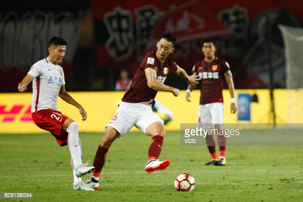 Luo Senwen of Hebei China Fortune and Yu Hai of Shanghai SIPG vie for the ball during the 21st round match of 2017 China Super League between Hebei...