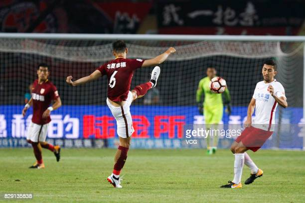Luo Senwen of Hebei China Fortune kicks the ball during the 21st round match of 2017 China Super League between Hebei China Fortune FC and Shanghai...